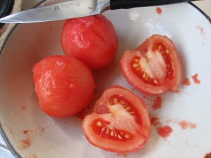 Cut them in half or quarters (depending on size) and use your thumbs to squish out the seeds.