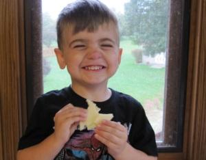 """Cheeeeeese!"" he says, while holding cheese. Haha, again, Goofball!"