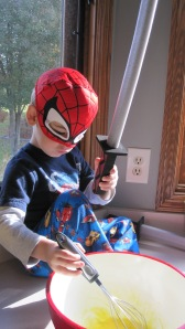 He might look like Spiderman to you, but he is a ninja.  That is a ninja sword.