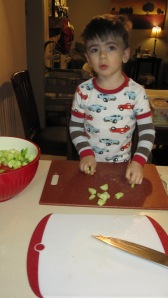 We use the two cutting board method a lot!  He knows he's not allowed to touch the veggies until they're on his board.